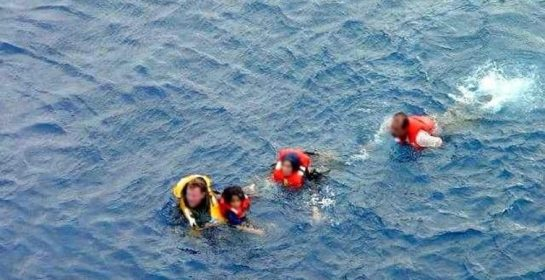 Navy footage of the HMAS Adelaide crew rescuing passengers of the sinking SIEV-4. (Photo: AAP)