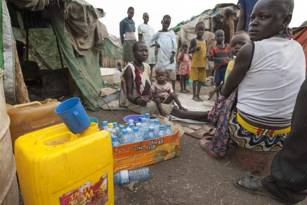 People collecting water at a refugee camp in Juba, South Sudan.