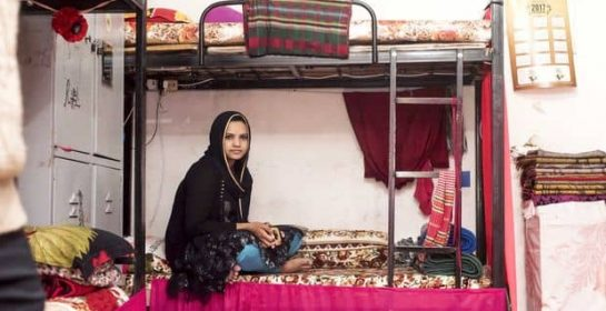 An employee rests inside the room she shares with nine other migrant workers (Alisa Reznick:MEE)