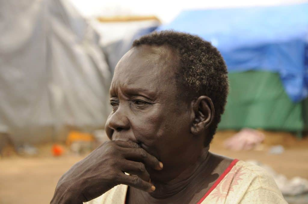 The old survivor women inside the IDP camp summon up her suffering during the conflict in Juba 13 Oct 2013 (Photo: Jok Solomun)