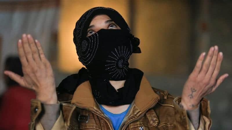 A displaced Yazidi woman, who was kidnapped by ISIL but managed to flee, is photographed in Duhok province, northern Iraq, November 24, 2016 [Ari Jalal/Reuters]