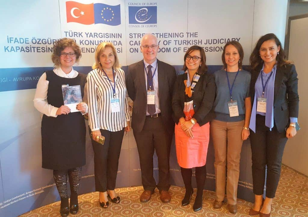 Aidan White with the event organisers, including Turkey Press Council chair Pinar Turenc, (second left)