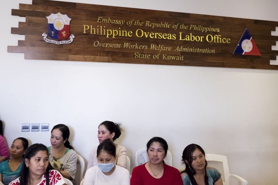 Filipina domestic workers await medical attention at the embassy shelter. Credit: Alisa Reznick/PRI